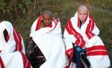 Estiaan Swanepoel and his friend Ndibulele Soboyisi at initiation school.