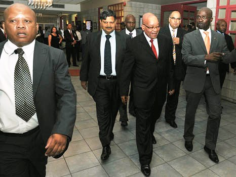 Photo of president Zuma walking with other men