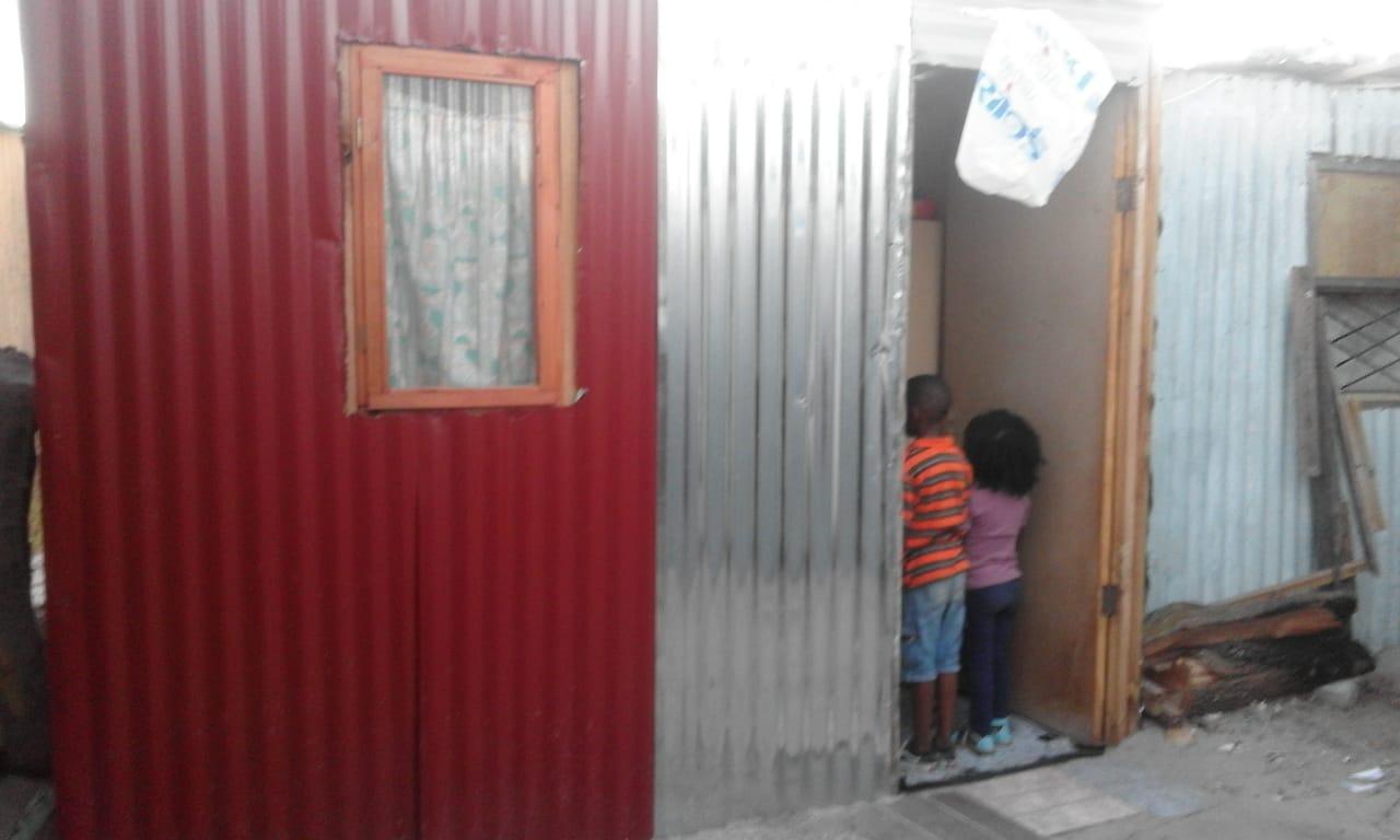 Photo of children in shack