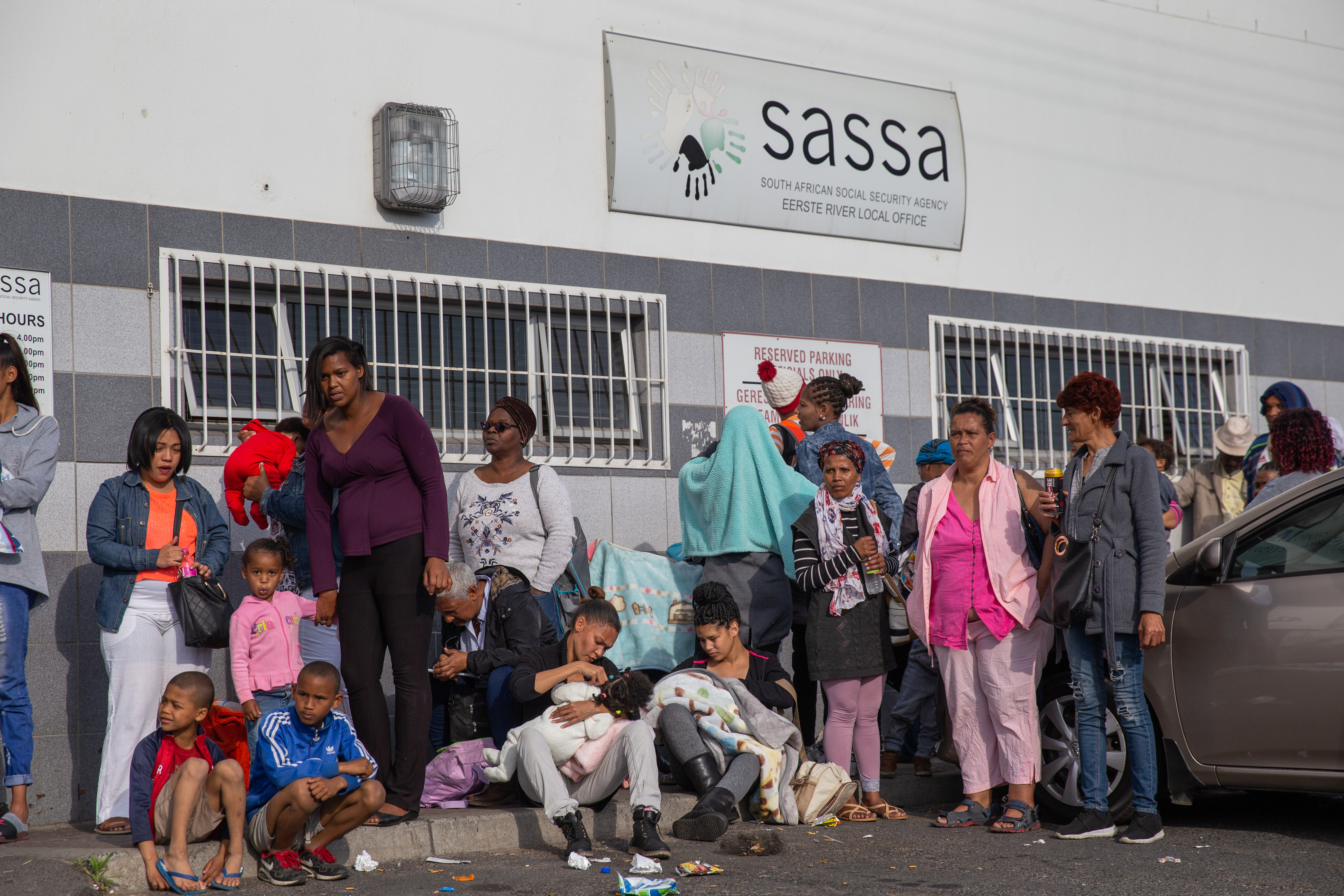 Photo of social grant beneficiaries outside a SASSA office