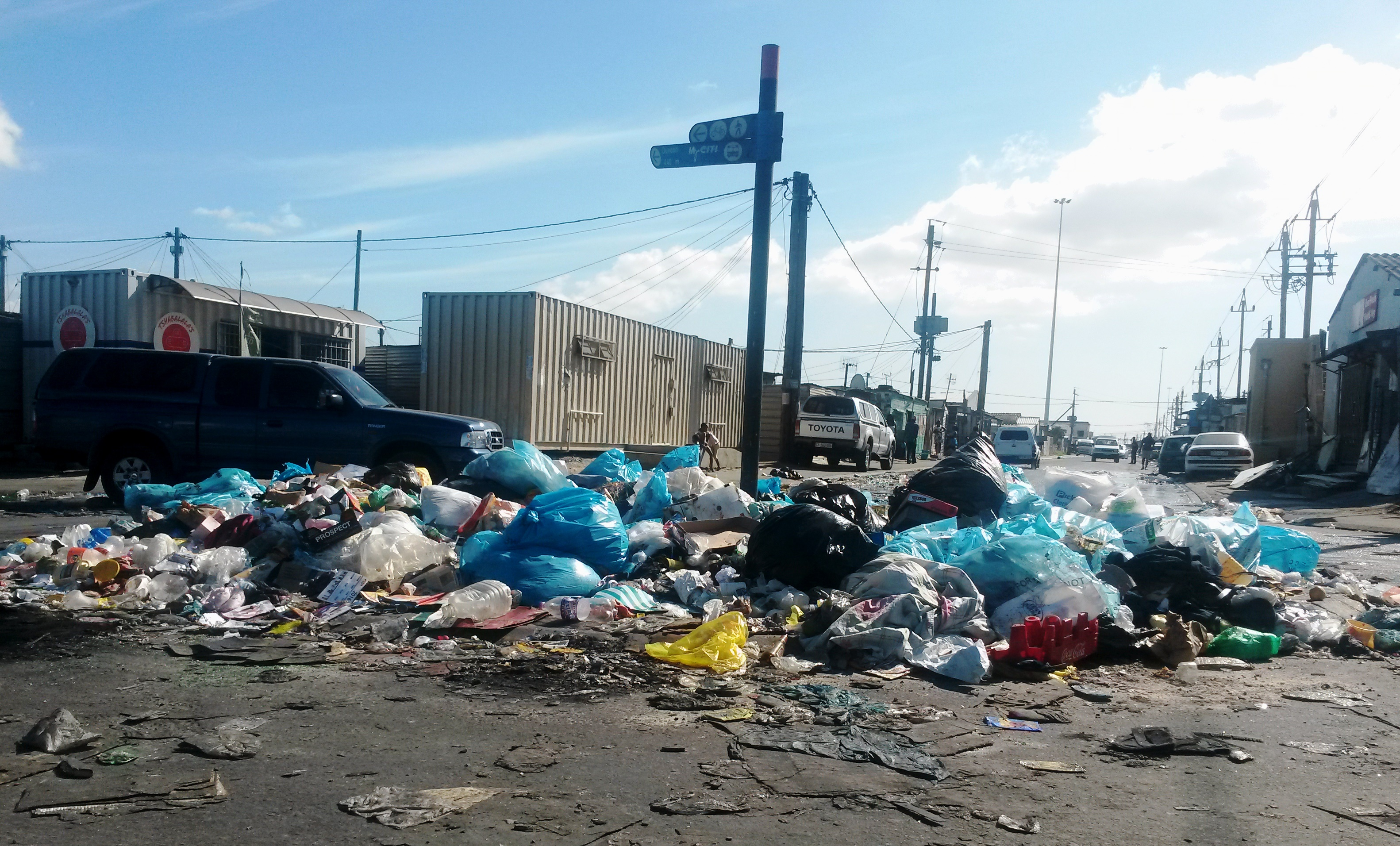 Photo of piles of rubbish in a road