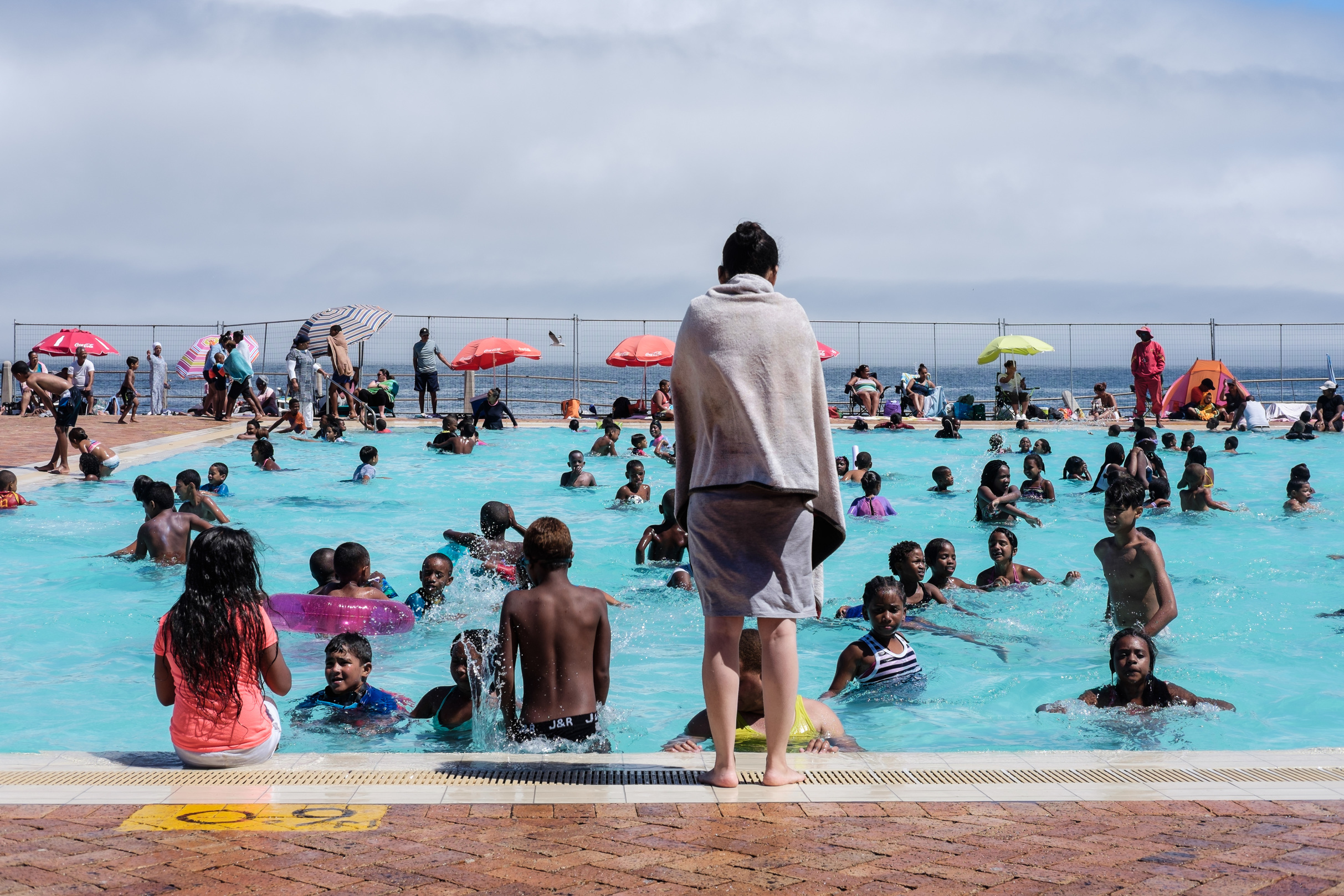 Photo Of People Swimming In Sea Point Pavilion