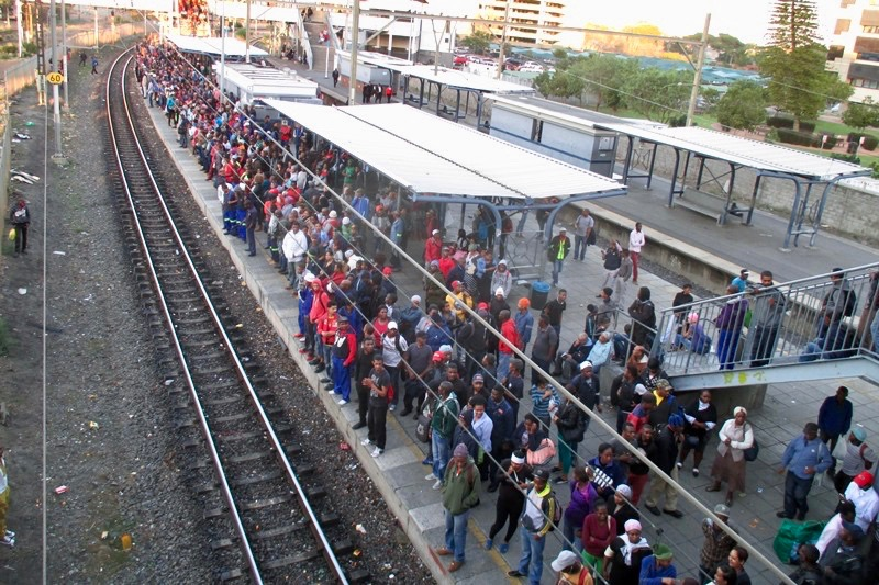 Photo of crowded train station platform