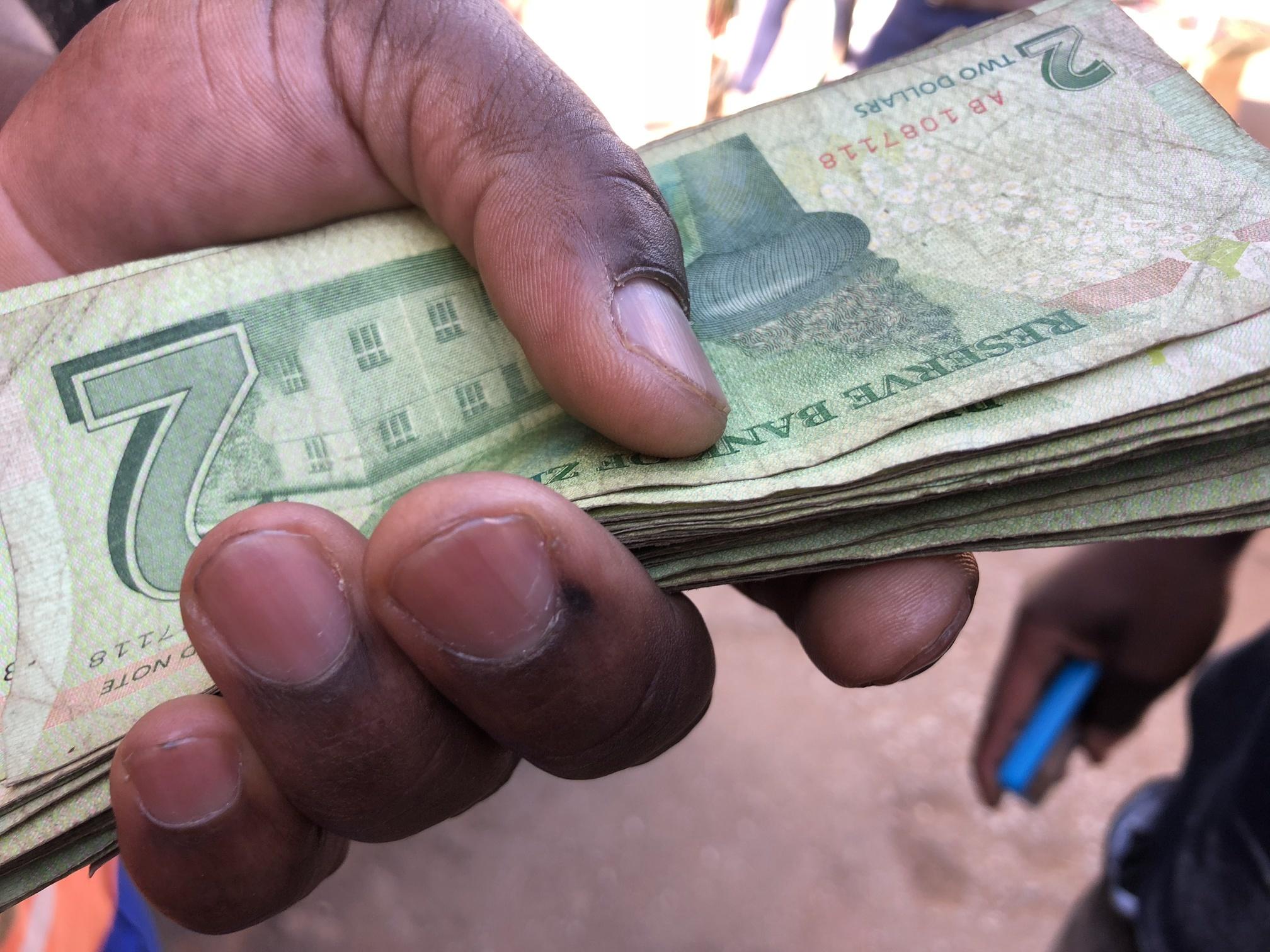Photo Of Zimbabwe Bond Notes Being Exchanged