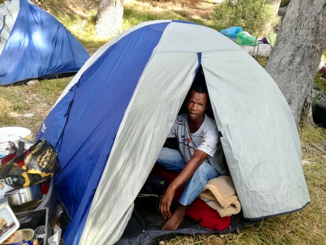Photo of a man in a tent