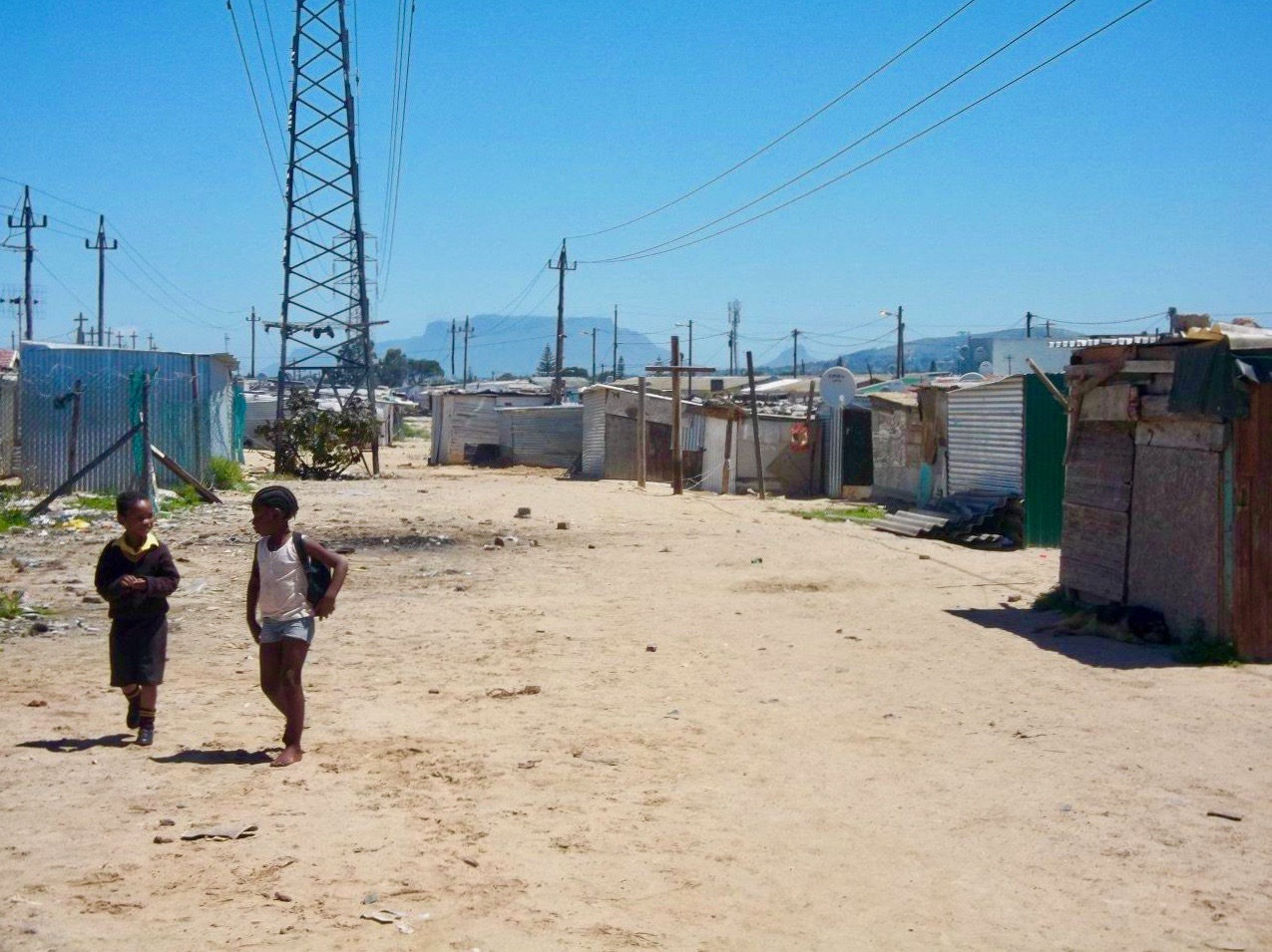 Neighbours provide water and electricty to informal